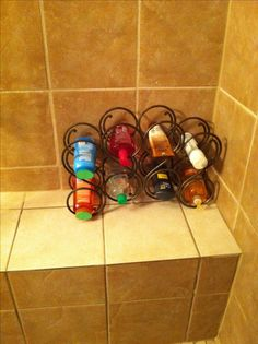 Repurposed Wine Rack Shower Organizer : eliminates clutter, rust rings & falling shampoo bottles. I love this idea!