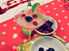 Lighter berry mojito. #Cocktail #Christmas #Non-alcoholic Ingredients: Raspberries and blackberries (about ¼ cup) A few sprigs of fresh mint 1 cup of your favourite carbonated mineral water Half a lime (2 wedges for garnish and 2 cut in half)