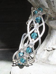 Wire wrapped Braided Bangle Bracelet with Swarovski Crystal made to order. $89.00, via Etsy.