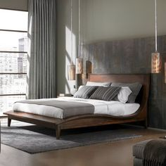 The metal pendant lights flanking the bed in this bedroom add to the industrial, urban feel of the space. A neutral color scheme gives the room an easygoing vibe, making it an ideal bedroom retreat.