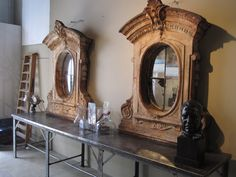 Metal Belgian industrial table ca. 1900 shown with two zinc architectural windows converted to mirrors.