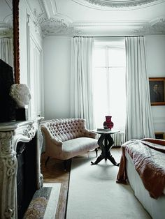 Paris apartment -- the molding, the couch, the fireplace, high ceilings