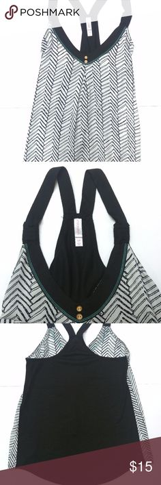"""Xhilaration Black/White Women's Tank Top Size S Xhilaration Tank Top Women's Size Small  - Black and white arrow pattern. - Black racer back. - Teal detailing and two wooden buttons on neckline. - Front: 100% Polyester; Back: 65% Polyester, 35% Rayon; Made in China.  Measurements (approximate): Length (from underarm to bottom hem): 17"""" Underarm to underarm (laying flat): 16"""" Xhilaration Tops Tank Tops"""