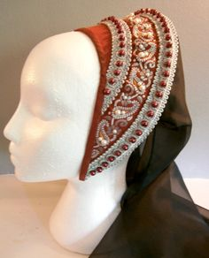 This beautiful french hood will sure be a head turner at renfaires. It is made of taffetta in dark red with jacquard lace in dark red with