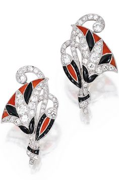 PAIR OF PLATINUM, DIAMOND, ONYX, HARDSTONE AND ENAMEL EARCLIPS, FRANCE Designed as stylized flowers set with old European and single-cut diamonds weighing approximately 3.00 carats, decorated with onyx, black enamel and hardstone of orange hue, with French assay marks.