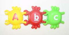 Alphabet Crabs (26 pieces) -- (5*.3) Various colored plastic crabs. Upper case letters on one side and lower case letters on the other side.