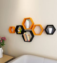 Buy DecorNation Black & Orange MDF Hexagon Wall Shelf - Set of 6 Online: Shop from wide range of TEST Online in India at best prices. Living Room Partition Design, Room Partition Designs, Tv Wall Design, Bookshelf Design, Wall Shelf Decor, Home Wall Decor, Wall Shelves, Hexagon Wall Shelf, Wall Painting Decor