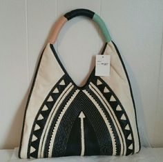 NWT Melie Bianco Selma Tribal Shoulder w/ Dust Bag With it's intricate details and symmetrical design this bag is sure to wow. The long shoulder strap also fits comfortably over your shoulder. 3 pockets (1 zipper pocket)  Handle Drop:	11.5' Dimensions:	16'L x 4.5'W x 10'H Melie Bianco Bags Shoulder Bags