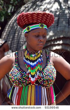 LESEDI CULTURAL VILLAGE, SOUTH AFRICA - JAN 1: Zulu woman wearing handmade clothing on January 1, 2008 at the Lesedi Cultural Village in South Africa. Beads are a pride of  the Zulu nation. by InnaFelker, via ShutterStock