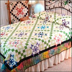 Love the 9 patch on this quilt.  You can make 2 versions, one for summer and then one for winter with the darker  colors.