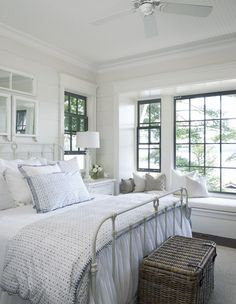 A beautiful neutral cottage style bedroom with farmhouse touches.