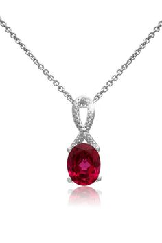 This beautiful necklace features one 9x7mm oval shape created ruby gemstone at 2.60 carats.   Total gem weight is 2.61 carats.  This necklace is crafted in platinum overlay and comes with an 18 inch cable chain with spring ring clasp.  Pendant measures 12x7mm. Ruby Ribbon Necklace by Passiana. New York City