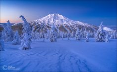 "Beautiful Blue Bachelor - Mt Bachelor, Oregon, about 30 minutes before sunrise.  This is my home mountain here in Bend, OR.  So many adventures and good times here.  Last week, I strapped on my split board and hiked into the mountains for sunrise.  It was a gorgeous, cold, clear morning.  I took my GoPro with me and recorded my snowboard run down in 2 feet of fresh powder, you can see it here:  <a href=""https://www.youtube.com/watch?v=3_ab2s9Epws"">Powder Surfing</a>  I used my advanced…"