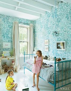Miranda Brooks' home - Vogue. Blue floral wallpaper in girls room.