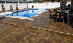 Pool decks can be stamped and stained in a decorative way to provide textures and color. It is always treated and sealed to resist harsh pool chemicals. #StampedPoolDecks #StampedConcrete