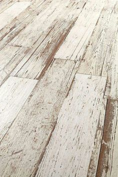 I can't believe this is actually tile that looks like old worn wood, can you? http://www.trendir.com/wood-look-tiles/
