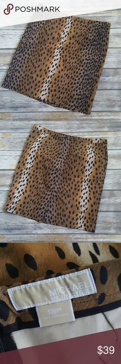 """Michael Lord cheetah print skirt Excellent condition. Beautiful cheetah print. Can be worn to work or out for a girls night. Cute slit in the back Length 19.5"""" Size 12p MICHAEL Michael Kors Skirts Pencil"""
