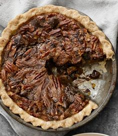 The earthiness of bittersweet chocolate and rich pecans melds with layers of sweet filling for a deep flavor everyone will linger around the table to savor. Recipe: Chocolate-Chunk Pecan Pie   - CountryLiving.com