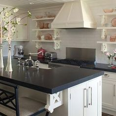 Incredible Kitchen With White Cabinetry, Jet Mist Honed Black Granite  Countertops And A Carrera Sticks Backsplash.