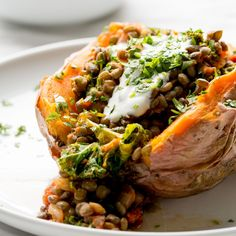 Stuffed Sweet Potatoes with lentils, kale and sun dried tomatoes are a great warming meal when it's freezing cold outside! Can I just say, I am so over this cold weather. Not even so much the cold as the darkness. Every day it's completely dark by 5.30/6, and on cloudy days it never even gets …