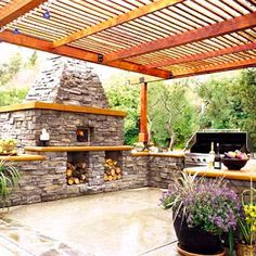 Patio with outdoor brick oven and pergola.
