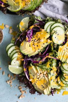 AVOCADO CUCUMBER SALAD WITH CARROT GINGER DRESSING