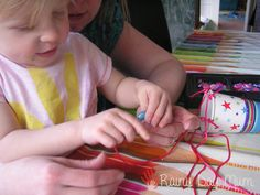 Toddler craft making a wind chime