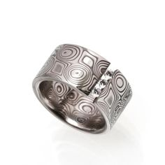 I'm fascinated by the tension-set diamonds. Ring by G. Phil Poirier