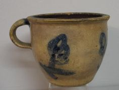 STONEWARE CROCK. Small crock with an applied hand