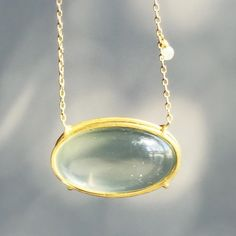 A sage green moonstone pendant with a tiny grey accent diamond by Rosanne Pugliese. #18k #greenmoonstone #rosannepugliese #finejewelery #jewellery #futureheirlooms #lovegold #augustla