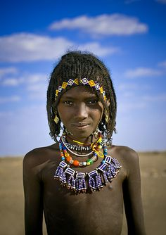 https://flic.kr/p/4UgFHF | Afar Tribe Girl With Big Necklace And Braided Hair, Assaita Danakil, Ethiopia | A young afar girl, not yet married, cos you can see her hair. Later (but not too much), she'll marry her cousin. As many young girls, she may be infibulated...So the wedding night will start with a knife... That's the way some afars still do. The afars live in a triangle between Ethiopia, Eritrea and Djibouti. Few years ago, they asked for independance, and war took place...Now, they…