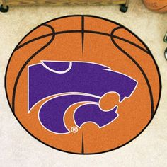 For basketball fans of all ages, our FANMATS Round Carpet Basketball Rugs were made for you. The NCAA team logo is featured in the center of a luscious rug that looks like an actual basketball. High quality construction ensures the rug will last for Kansas State Basketball, Chino Hills Basketball, Wildcats Basketball, Basketball Floor, Kansas State University, Kansas State Wildcats, Basketball Pictures, Chicago Logo, Area Rug Sizes