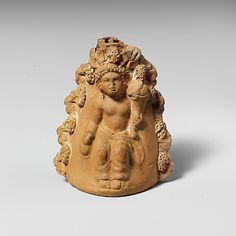 Terracotta oinochoe (jug) with a seated boy  Period: Late Classical Date: 4th century B.C. Culture: Greek, Attic