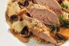 """You don't need to wait for Sunday night to make a comforting roast dinner. The pork stays moist and the potatoes taste wonderful in the mushroom """"gravy"""". Roasted Pork Tenderloins, Stuffed Mushrooms, Stuffed Peppers, Mushroom Gravy, Roast Dinner, White Potatoes, Glass Baking Dish, Filets, Healthy Eating Tips"""