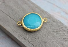 A personal favorite from my Etsy shop https://www.etsy.com/listing/218182967/turquoise-jade-30mm-bezel-connector-link
