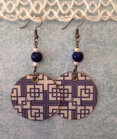 A personal favorite from my Etsy shop https://www.etsy.com/listing/490803543/up-cycled-blue-geometric-print-earrings