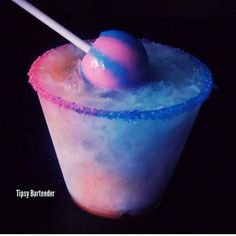 COTTON CANDY CRUSH  Rim glass with Blue & Pink Sugar, and Coconut Cream, Fill with crushed ice. ½ oz. (15 ml) Cotton Candy Vodka ½ oz. (15 ml) Vanilla Rum ½ oz. (15 ml) Coconut Cream 2 oz. (60 ml) Coconut Milk  Shake and strain into prepared glass. Drizzle Grenadine on one side and drizzle Blue Curacao on the other. Garnish with Cotton Candy Lolli