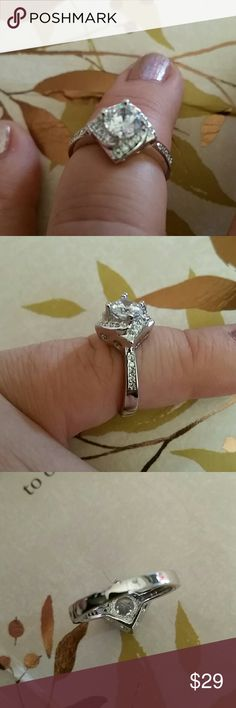 Hearts and Arrow 2 CTW AAA CZ Ring Size 6 Gorgeous sparkle, unique design. Platinum over 925 silver. Stamped S925. AAA CZ 11/2 carat center stone. Pave setting celtic knot halo surround. Pave up sides of band. So pretty. Great engagement ring, promise ring, replacement ring for vacation, or coctail ring. One available. Size 6 Jewelry Rings