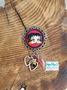 Betty Boop nurses badge reel. Check out this item in my Etsy shop https://www.etsy.com/listing/546987323/betty-boop-id-badge-reel-clip-hearts