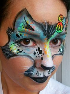 Fantasy cat face paint - love the stencil with rainbow colors