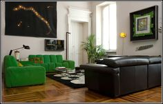 Milan Apartment. Excellent moldings and wood floorboard pattern. Black with white and beige, green to pop. Constellation/city lights wall art.