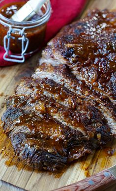 Oven-Barbecued Beef Brisket recipe from Cook's Illustrated. The best brisket cooked in the oven you will ever taste. Wrapped in bacon for smokiness and slow cooked. A few minutes under the broiler gives the outside a nice char.