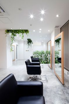 Hair Salon Design: Comfort and Relaxing Atmosphere: Black Comfortable Chairs In Appealing Hair Salon Interior