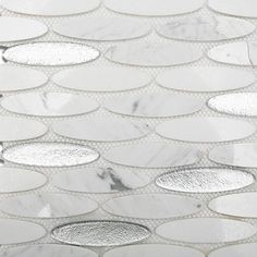 Shop 12 x 12 Kinetic Ice Water Ovals Polished Glass + Stone Tile in Metallic Silver, White Thassos, and Asian Statuary at TileBar.com.