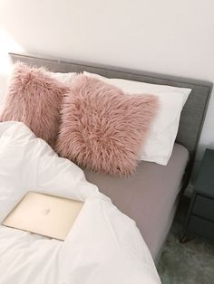 A fur pillow for those who love cozy touch in their bed