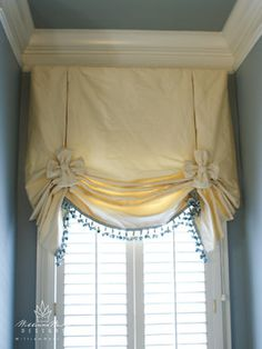 London Shade Design--Like the idea of using the old fashion curtin rod b/c it wraps around the ends for more insulation
