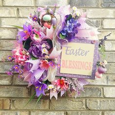 Easter wreath in pinks and purples.  Product Description: Handmade Wire Wreath Form 21 Ivory burlap mesh 10 Pink burlap mesh 10 Purple mesh with white stripes 2.5 Wired ribbon in purple plaid 1.5 Wired ribbon in pink stripe Floral accents Wood sign  Wreath Measures approx. 18 in diameter, 6 Deep  The elements and/or sign are securely attached and no glue was used in the process. This wreath is made to hang in a protected area outside or anywhere inside using appropriate hardware. Never h...