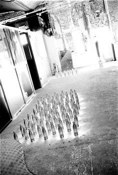 Silver Coke Bottles drying on the Factory floor, 1964 | Andy Warhol Silver Factory | Photograph by Billy Name