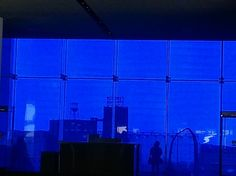 Looking out to the Endless Bridge through the blue glass window at the Guthrie Theater, Minneapolis, MN