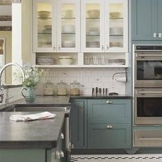 Thinking of painting the base cabinets but not the tops. I like this color combo!